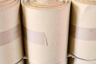 Embossed paper in reel format