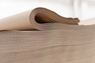Sheeted embossed natural recycled material