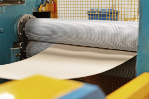 Produces wavy line embossed sheets from reel material